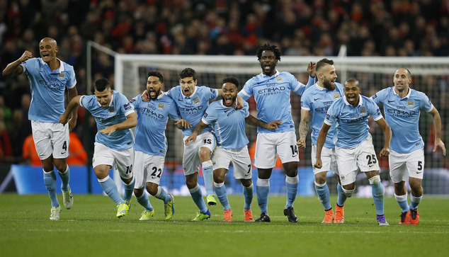 Manchester City players celebrate after winning the English League Cup final soccer match between Liverpool and Manchester City at Wembley stadium in London, Sunday, Feb. 28, 2016.(AP Photo/Kirsty Wigglesworth)